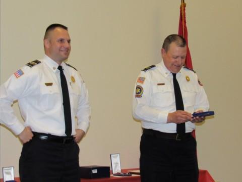 Chief Laughy with Chief Bratton accepting Lt Cargile Jr Off of Year