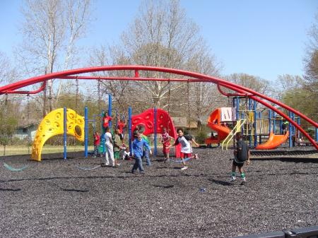 Children running about the Playground at Fireman Park